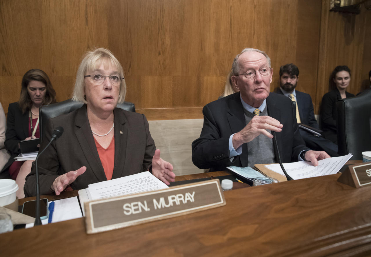 "FILE - In this Oct. 18, 2017, file photo Sen. Patty Murray, D-Wash., the ranking member, and Sen. Lamar Alexander, R-Tenn., chairman of the Senate Health, Education, Labor, and Pensions Committee, talk before the start of a hearing on Capitol Hill in Washington. The polarizing politics of abortion have burst into the congressional budget debate, overwhelming bipartisan efforts to help millions of consumers who buy their own health insurance policies get relief from soaring premiums. Lawmakers of both parties have been negotiating over a health insurance stabilization bill for months, and some experts estimate such legislation could reduce premiums by 20 percent to 40 percent, after two years of relentless increases. One of the leading Democratic negotiators, Murray, on March 19, 2018, called the Republican offer ""partisan,"" adding that it came as a surprise.(AP Photo/J. Scott Applewhite, File)"