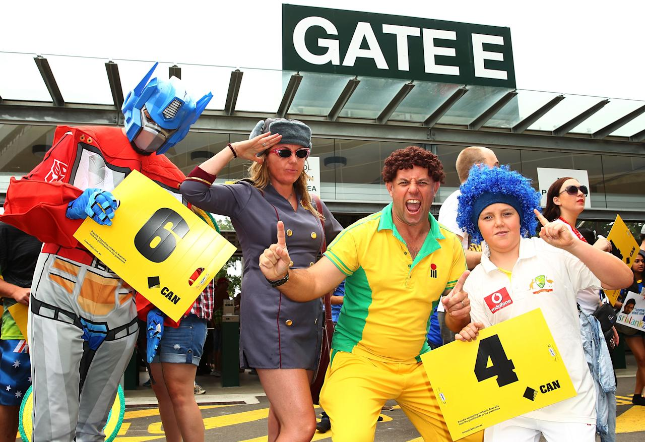 SYDNEY, AUSTRALIA - JANUARY 20:  Cricket fans dressed up in costume  pose just prior to the  commencement of game four of the Commonwealth Bank one day international series between Australia and Sri Lanka at Sydney Cricket Ground on January 20, 2013 in Sydney, Australia.  (Photo by Don Arnold/Getty Images)