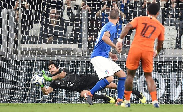 Italy goalkeeper Mattia Perin makes a save during the friendly soccer match between Italy and The Netherlands at the Allianz Stadium in Turin, Italy, Monday, June 4, 2018 (Alessandro Di Marco/ANSA via AP)