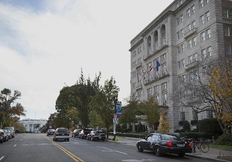 A view of the Hay Adams Hotel, right, looking toward the White House in Washington, Thursday, Nov. 14, 2013. Two U.S. Secret Service officers are under investigation and have been removed from President Barack Obama's detail following allegations of misconduct, according to The Washington Post. The investigation stems from an incident during the spring at the Hay-Adams Hotel, an upscale hotel steps away from the White House, involving a senior supervisor responsible for about two dozen agents in the presidential security detail. (AP Photo/ Evan Vucci)
