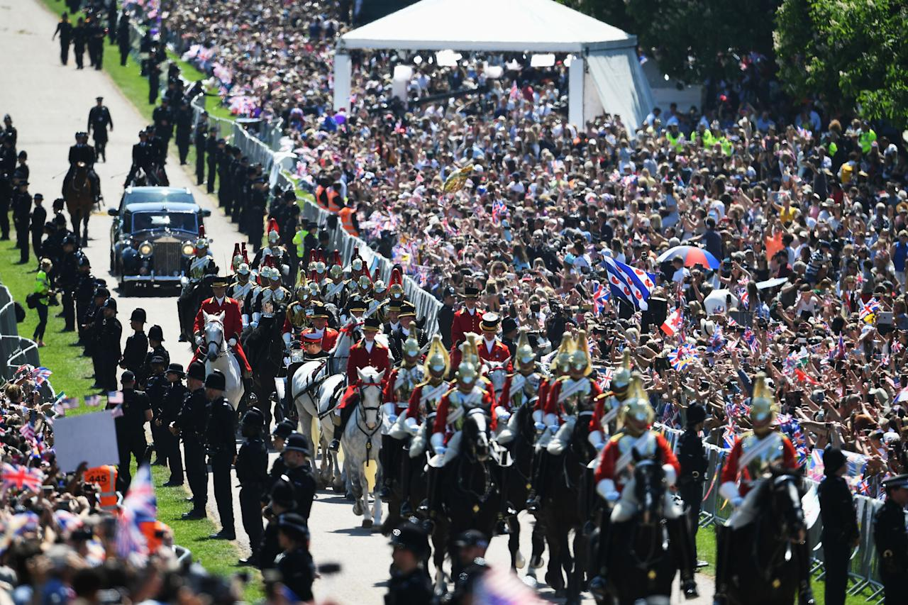 <p>Eyes forward: Thousands packed out the Long Walk outside Windsor Castle before the ceremony. (Getty) </p>