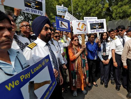 """Jet Airways employees and their family members attend a protest demanding to """"save Jet Airways"""" in New Delhi, India, April 18, 2019. REUTERS/Adnan Abidi"""