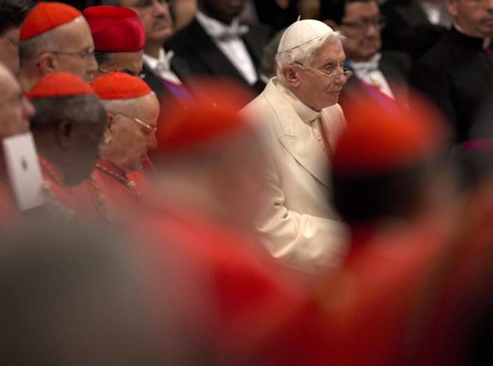 Pope Emeritus Benedict XVI attends consistory inside the St. Peter's Basilica at the Vatican, Saturday, Feb.22, 2014. Benedict XVI has joined Pope Francis in a ceremony creating the cardinals who will elect their successor in an unprecedented blending of papacies past, present and future. (AP Photo/Alessandra Tarantino)