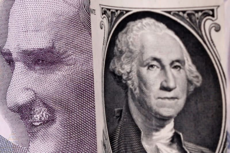 Turkish lira and U.S. dollar banknotes are seen in this illustration