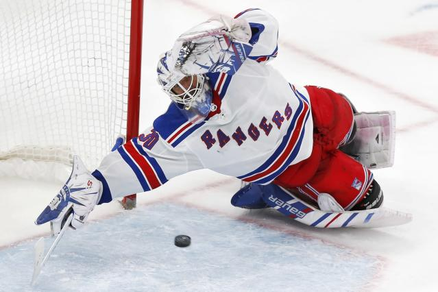 New York Rangers' Henrik Lundqvist can not stop the winning goal by Boston Bruins' David Krejci in overtime during an NHL hockey game in Boston, Friday, Nov. 29, 2019. (AP Photo/Michael Dwyer)