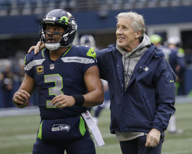 Pete Carroll and quarterback Russell Wilson have led the Seahawks to a lot of success. (AP)