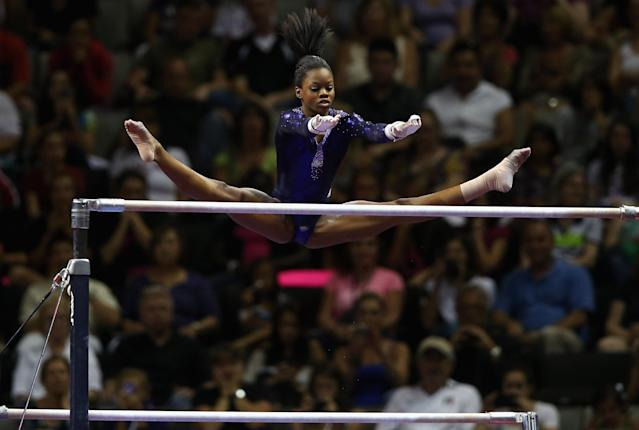 SAN JOSE, CA - JULY 01: Gabrielle Douglas competes on the uneven bars during day 4 of the 2012 U.S. Olympic Gymnastics Team Trials at HP Pavilion on July 1, 2012 in San Jose, California. (Photo by Ezra Shaw/Getty Images)