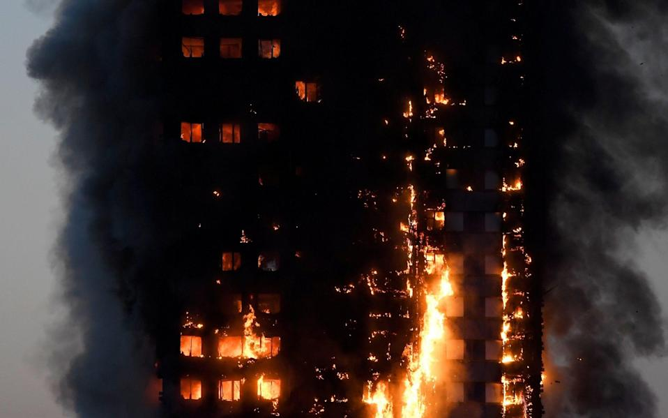 Flames and smoke billow as firefighters deal with a serious fire in a tower block at Latimer Road in West London - Credit: Reuters
