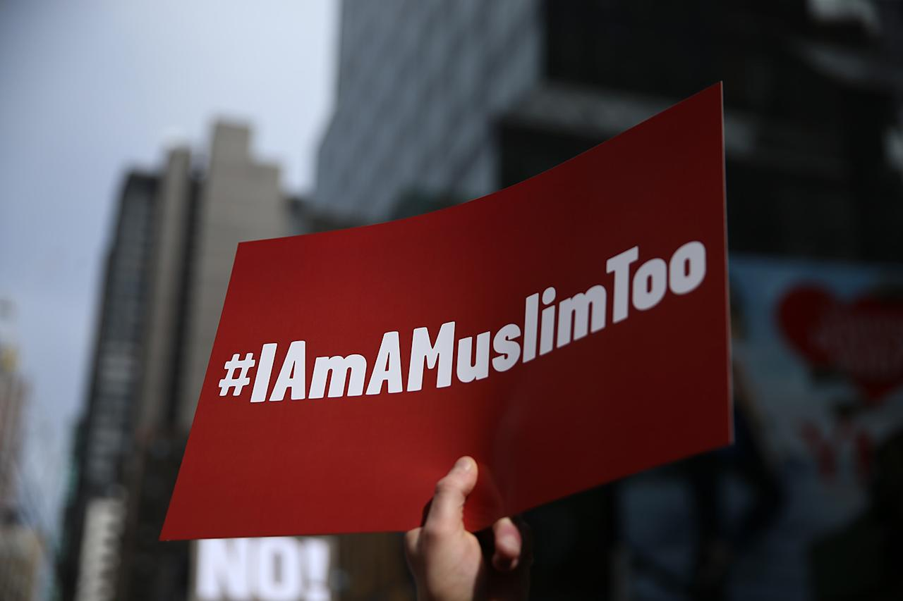 """<p>A protester holds a sign at the """"I am a Muslim too"""" rally at Times Square in New York City on Feb. 19, 2017. (Gordon Donovan/Yahoo News) </p>"""