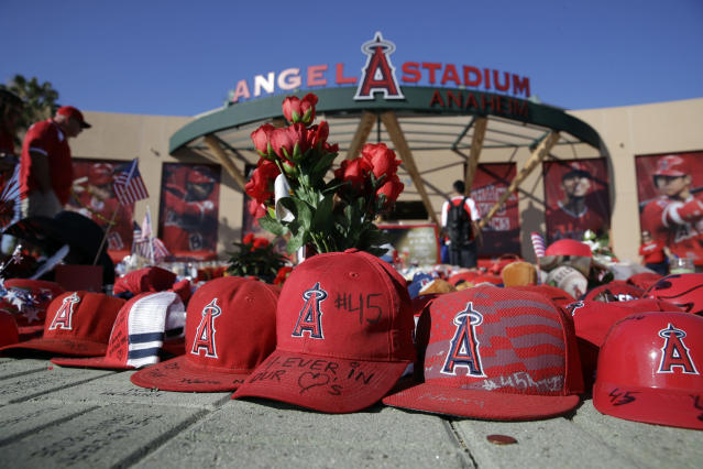 A makeshift shrine in honor of Los Angeles Angels pitcher Tyler Skaggs stands outside Angel Stadium before the team's baseball game against the Seattle Mariners on Friday, July 12, 2019, in Anaheim, Calif. (AP)