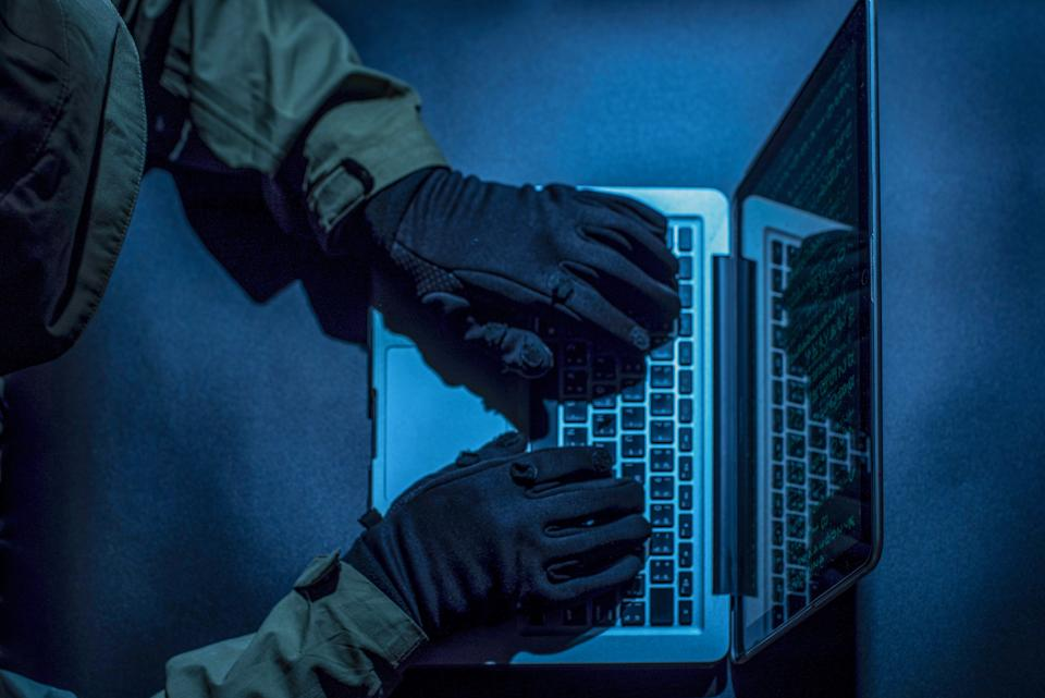 Hacker stealing password and identity (Photo: boonchai wedmakawand via Getty Images)