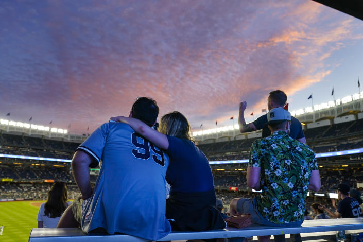 Fans watch during the fifth inning of the second game of a baseball doubleheader between the New York Yankees and the Toronto Blue Jays Thursday, May 27, 2021, in New York. (AP Photo/Frank Franklin II)