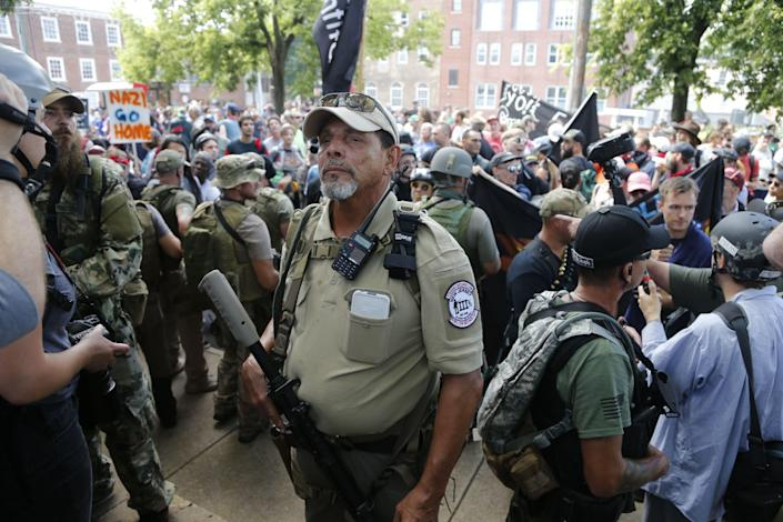 An armed man sporting a Three Percenter patch stands guard at a white nationalist rally in Charlottesville, Virginia.