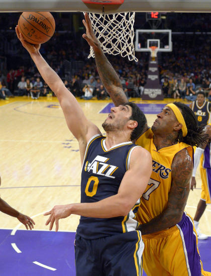 Jazz center Enes Kanter, left, is looking to expand his game offensively this season. (AP)