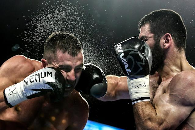 Oleksandr Gvozdyk (L) and Artur Beterbiev compete in a light heavyweight world title unification boxing fight at the Liacouras Center in Philadelphia; Beterbiev won the bout. (Getty Images)