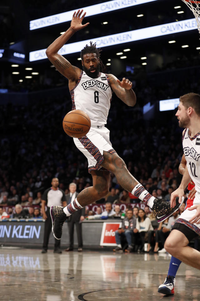 Brooklyn Nets guard Spencer Dinwiddie (8) leaps for the ball during the second quarter of an NBA basketball game against the Philadelphia 76ers at Barclays Center, Sunday, Dec. 15, 2019, in New York. (AP Photo/Michael Owens)