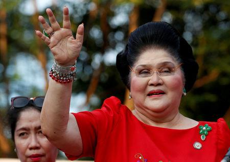 FILE PHOTO: Philippines Former First Lady and Congresswoman Imelda Marcos waves to supporters as she takes part in the announcement of her son BongBong Marcos' vice-presidential candidacy, in Manila Philippines October 10, 2015.  REUTERS/Erik De Castro/File Photo
