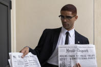 """This image released by Amazon Studios shows Kingsley Ben-Adir in a scene from """"One Night in Miami."""" (Patti Perret/Amazon Studios via AP)"""