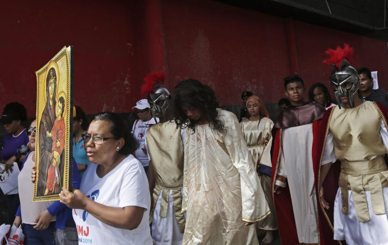 Jose Fuentes, center, portrays Jesus Christ during a Good Friday procession in Panama City on April 19, 2019. (Arnulfo Franco / ASSOCIATED PRESS)