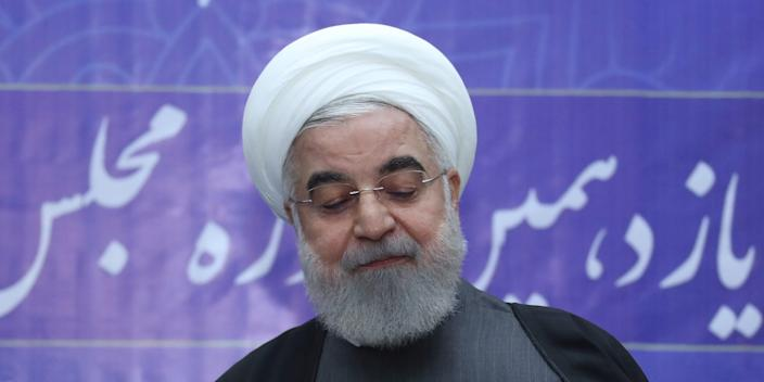 Iranian President Hassan Rouhani casts his vote at a polling station during parliamentary elections in Tehran, Iran February 21, 2020. Official Presidential website/Handout via REUTERS