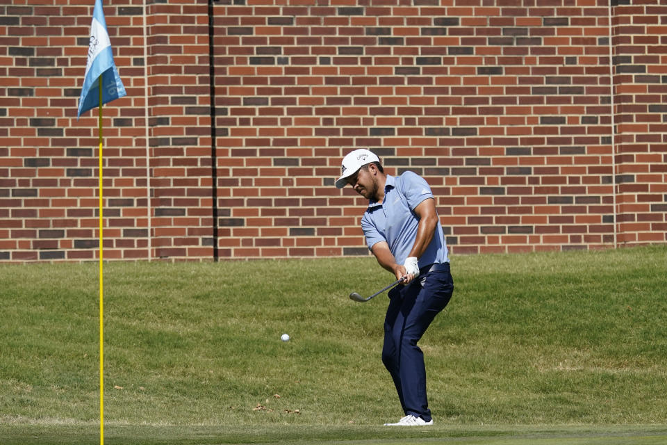 Xander Schauffele chips to the 16th green during the third round of the Charles Schwab Challenge golf tournament at the Colonial Country Club in Fort Worth, Texas, Saturday, June 13, 2020. (AP Photo/David J. Phillip)