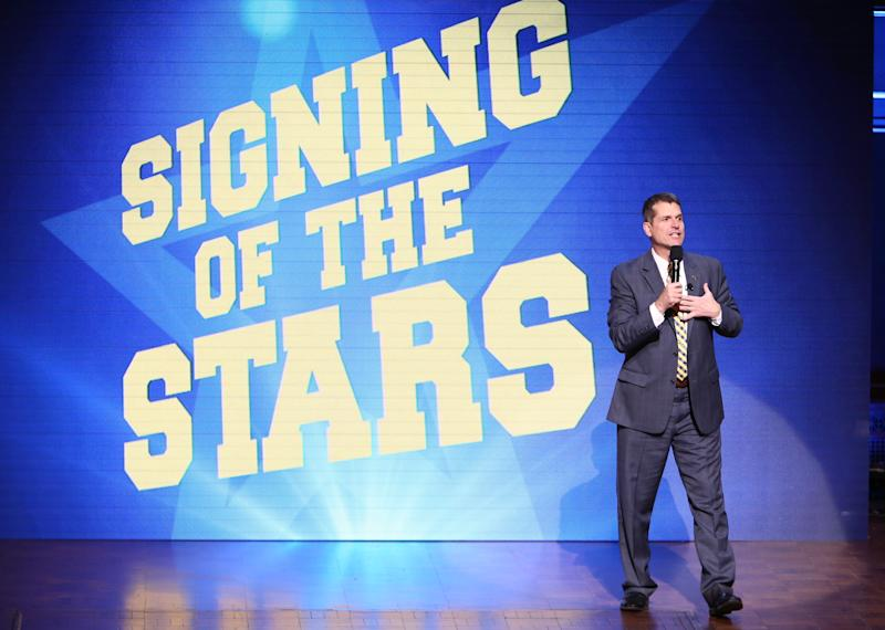 Jim Harbaugh, tasteful and restrained, on Signing Day 2016. (Rey Del Rio/Getty Images)