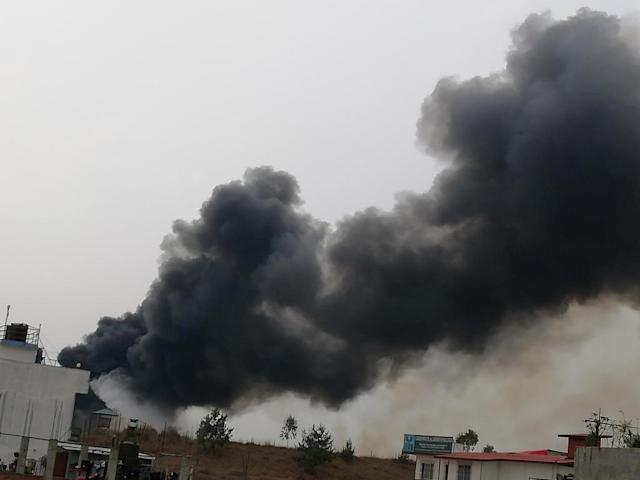 <p>Smoke rises following the crash of a Bangladeshi aircraft at Kathmandu airport, Nepal March 12, 2018, in this picture obtained from social media.(Photo: Rusha Giri/Via Reuters) </p>