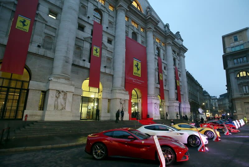 Ferrari's model cars are seen in front of the Milan's stock exchange