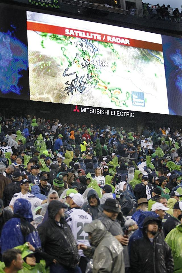 Weather radar is shown on a giant video screen at CenturyLink Field during a weather delay in an NFL football game between the Seattle Seahawks and the San Francisco 49ers, Sunday, Sept. 15, 2013, in Seattle. (AP Photo/John Froschauer)