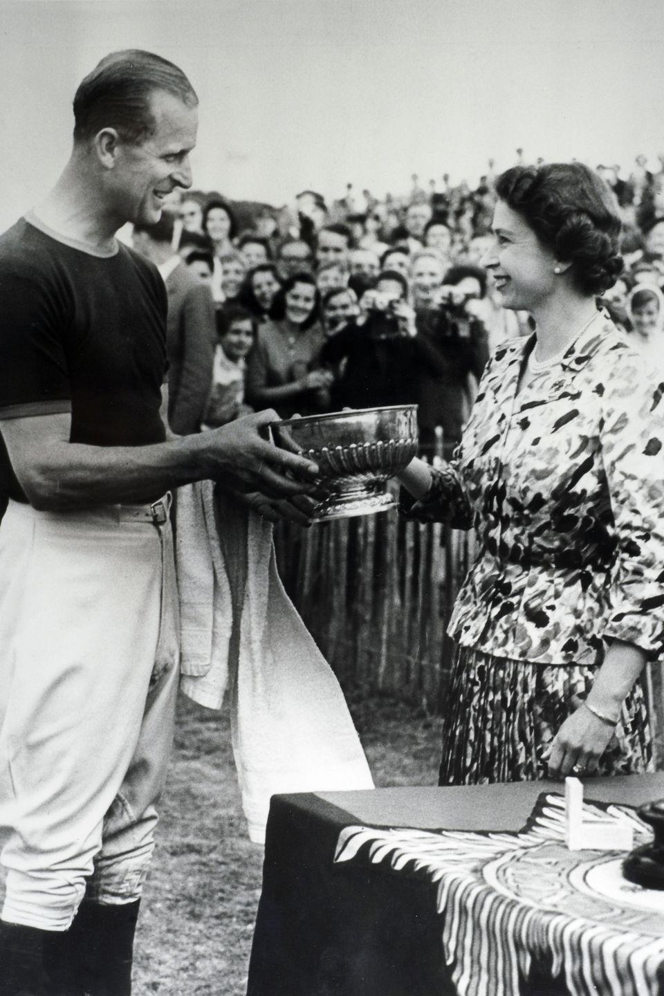 <p>Queen Elizabeth congratulates Prince Philip and presents him with a trophy following a polo match in the summer of 1957. </p>