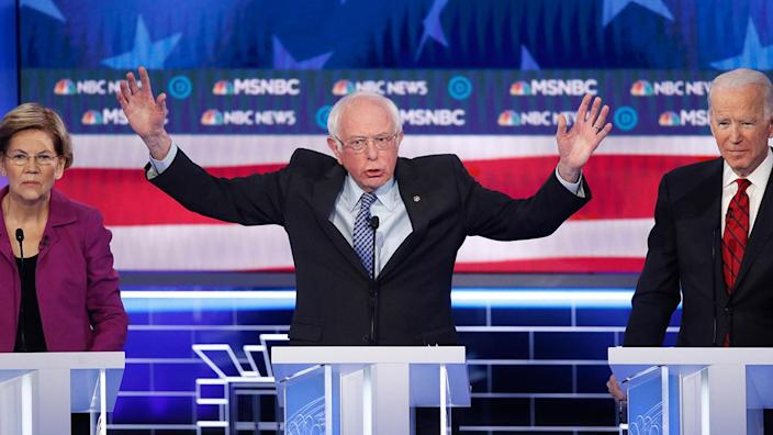 Bernie Sanders debating with Elizabeth Warren and Joe Biden in Las Vegas. (John Locher/AP)