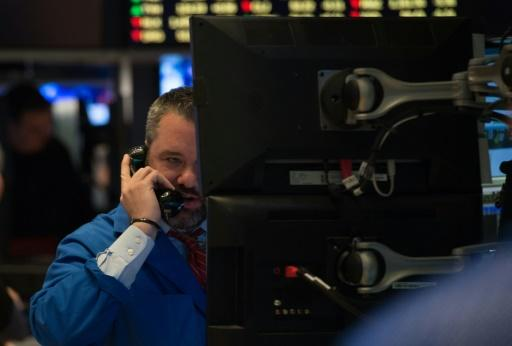US stocks end lower on concerns over tightening Fed policy