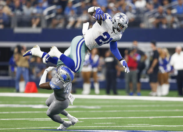 <p>Dallas Cowboys running back Ezekiel Elliott (21) leaps over Detroit Lions defensive back Tracy Walker (47) during the second half on Sunday, Sept. 30, 2018 at AT&T Stadium in Arlington, Texas. The Cowboys won 26-24. (Jim Cowsert/Fort Worth Star-Telegram/TNS via Getty Images) </p>