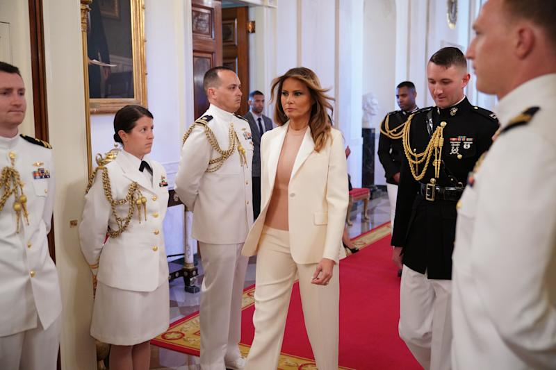 Melania Trump arrives at the Medal of Freedom ceremony wearing white Dior suit [Photo: Getty]