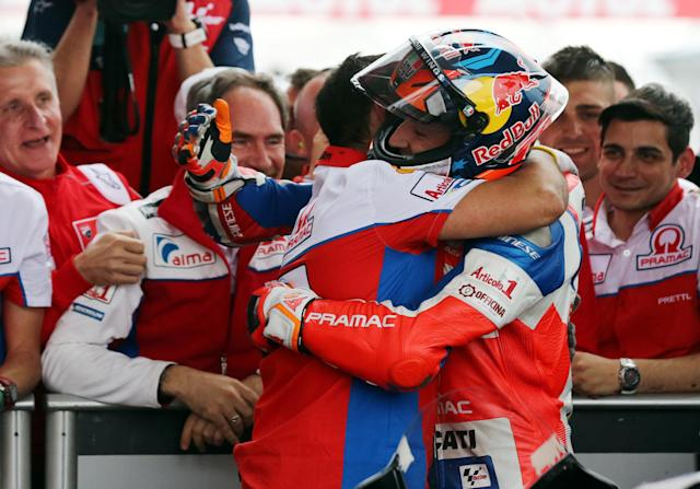 Motorcycle Racing - Argentina Motorcycle Grand Prix - MotoGP Qualifying Session - Termas de Rio Hondo, Argentina - April 7, 2018 - Alma Pramac Racing rider Jack Miller of Australia is embraced by a member of his team at the end of the qualifying session. REUTERS/Marcos Brindicci