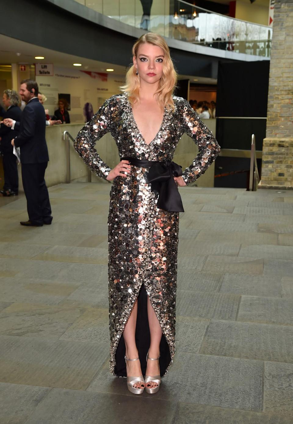 <p>Anya is proving to be a real style star in a low-cut sequinned Miu Miu gown.<br><i>[Photo: PA]</i> </p>