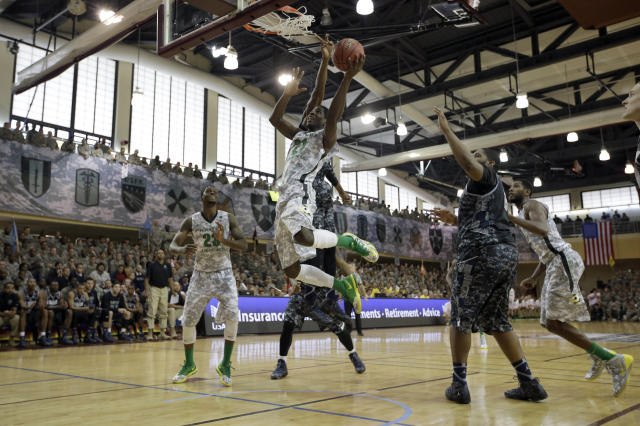 Oregon's Damyean Dotson (21) tries to shoot against Georgetown during the first half of an NCAA college basketball game in the Armed Forces Classic at Camp Humphreys in Pyengtaek, south of Seoul, South Korea, Saturday, Nov. 9, 2013. (AP Photo/Lee Jim-man)