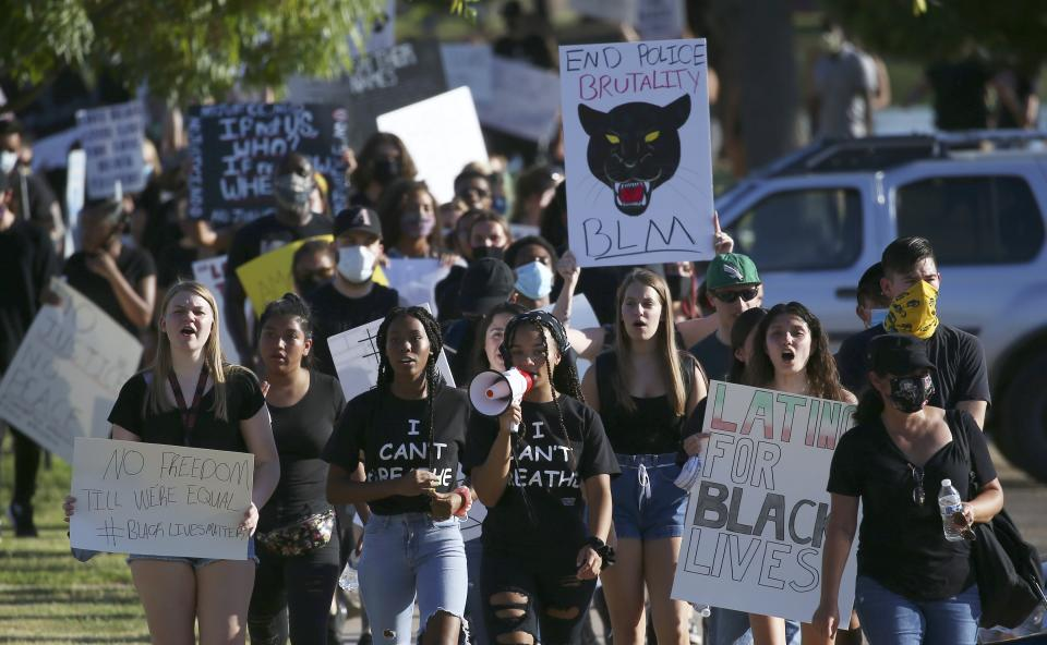 Protesters march during a rally at Cesar Chavez Park on Wednesday, June 3, 2020, in Laveen, Ariz. (Ross D. Franklin/AP)