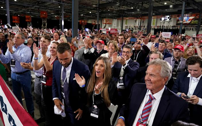 Supporters cheer as President Donald Trump speaks at a rally at Xtreme Manufacturing - AP