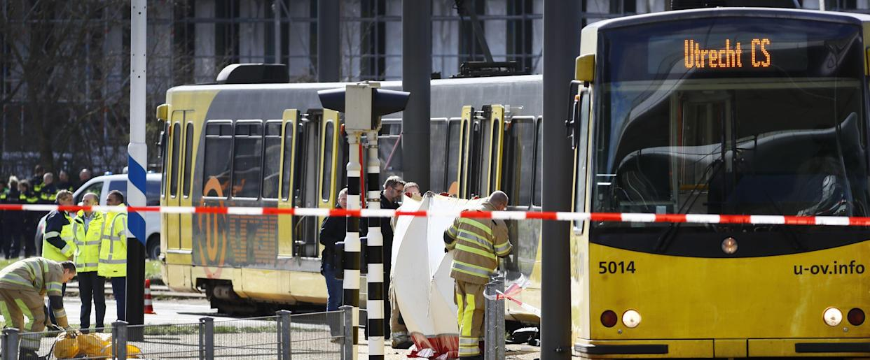 Police forces and emergency services stand at the 24 Oktoberplace in Utrecht, on March 18, 2019 where a shooting took place. (Photo: Robin Van Lonkhuijsen/AFP/Getty Images)