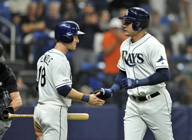 Tampa Bay Rays' Joey Wendle, left, congratulates Avisail Garcia after Garcia's solo home run off Chicago White Sox starter Lucas Giolito during the seventh inning of a baseball game Saturday, July 20, 2019, in St. Petersburg, Fla. (AP Photo/Steve Nesius)