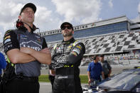 FILE - In this Feb. 11, 2018, file photo, crew chief Chad Knaus, left, and Jimmie Johnson watch the leaderboard during qualifying for the NASCAR Daytona 500 auto race at Daytona International Speedway in Daytona Beach, Fla. Johnson is retiring from full-time NASCAR competition in Sunday's season finale at Phoenix Raceway, leaving the sport as a seven-time champion ranked sixth on the all-time wins list with 83 career victories. (AP Photo/Terry Renna, File)
