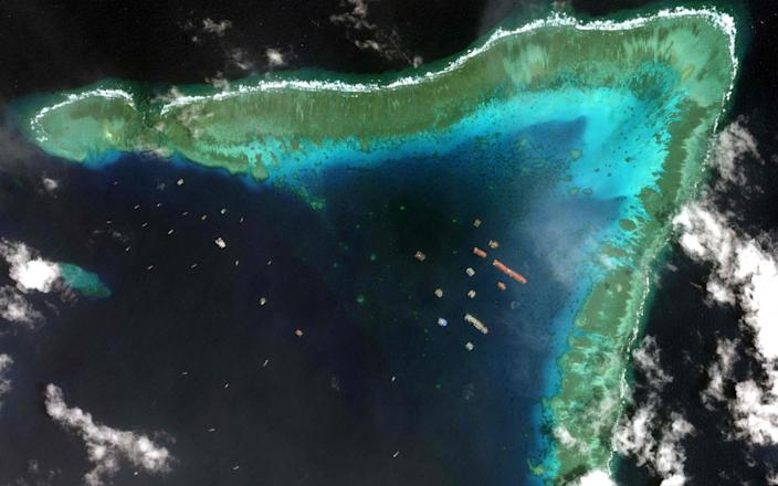 Satellite images show Chinese vessels anchored at the Whitsun reef - AFP