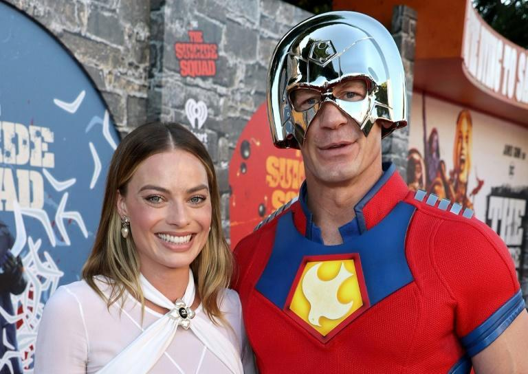 """Margot Robbie (L) and John Cena attend the Warner Bros. premiere of """"The Suicide Squad"""" at Regency Village Theatre on August 02, 2021 in Los Angeles, California"""