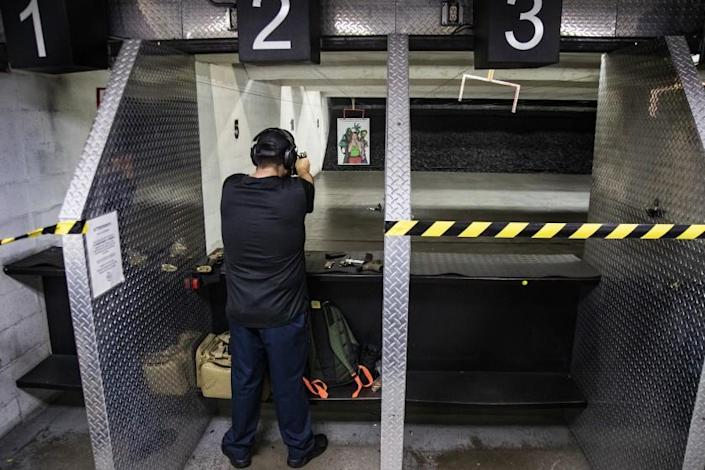 RIVERSIDE, CA - MARCH 31, 2020: Freddy Torres of Buena Park shoots his gun at Riverside Indoor Shooting Range during the coronavirus pandemic on March 31, 2020 in Riverside, California. (Gina Ferazzi/Los AngelesTimes)