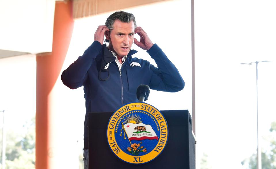 California Governor Gavin Newsom arrives to brief the media on the opening day of a new mass Covid-19 vaccination site established between the federal government and the state on February 16, 2021 on the campus at California State University of Los Angeles in Los Angeles, California. - The CSULA site, along with a similar site at the Oakland-Alameda Coliseum, will be co-run by the Federal Emergency Management Agency and the state of California through the governor's Office of Emergency Services and is expected to have an ultimate capacity of administering 6,000 doses per day in the fight against the coronavirus pandemic. (Photo by Frederic J. BROWN / AFP) (Photo by FREDERIC J. BROWN/AFP via Getty Images)