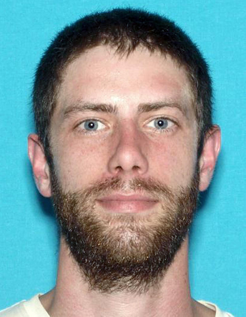 Manhunt Underway For Man Who Police Say Killed Officer and Robbed Store in Maine