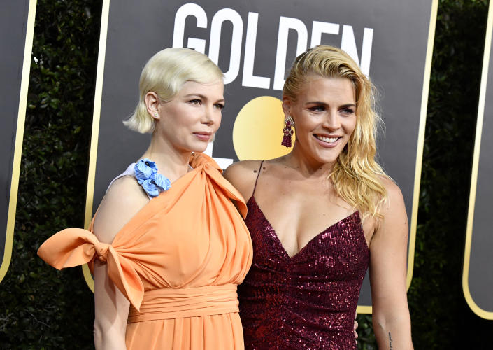 Michelle Williams and Busy Philipps wore the same lip colour on the Golden Globes red carpet. [Photo: Getty]