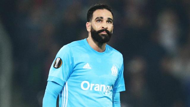 Marseille team-mates Adil Rami and Dimitri Payet attempted to play down a clash that led to them being separated on the pitch.