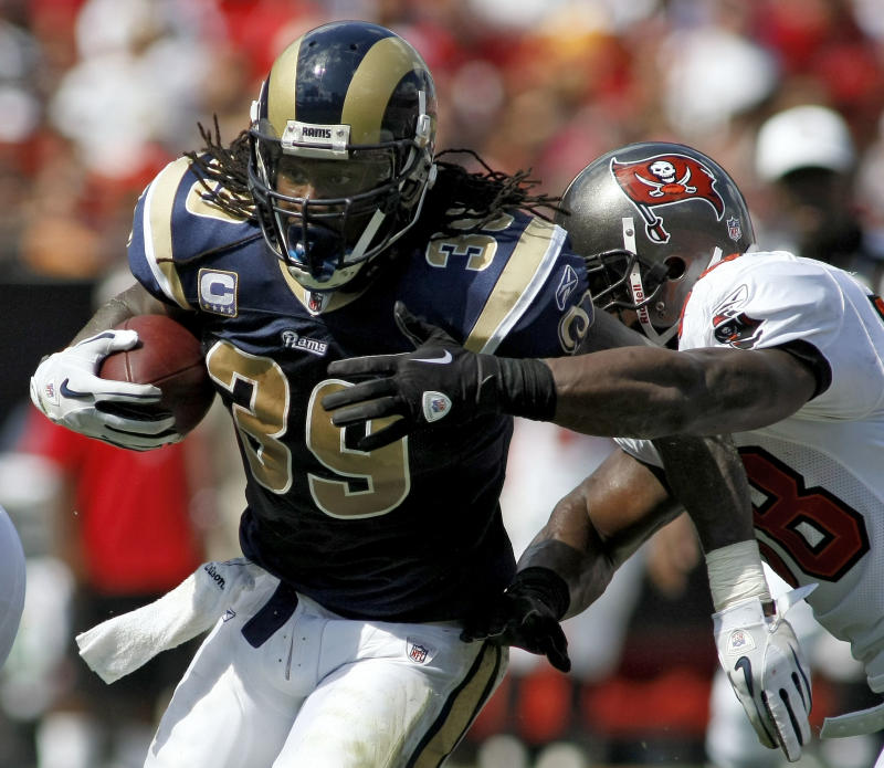St. Louis Rams running back Steven Jackson (39) breaks a first half tackle by Tampa Bay Buccaneers linebacker Quincy Black (58) during an NFL football game, Sunday, Oct. 24, 2010, in Tampa, Fla. (AP Photo/Brian Blanco)